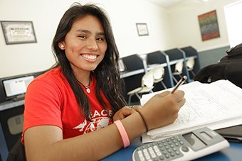 Girl smiling and studying