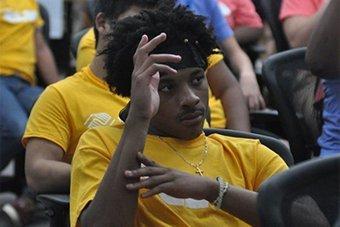 Teenager raising hand